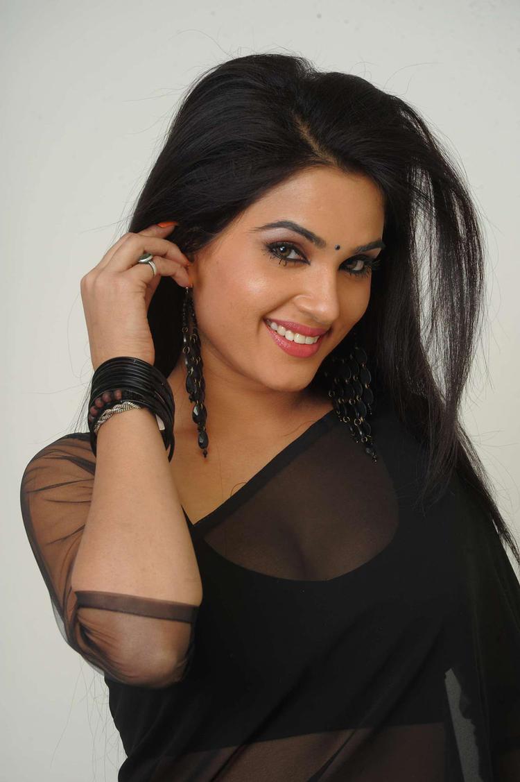 Kavya Singh Sexy In Black Saree Still From Movie Sorry Teacher