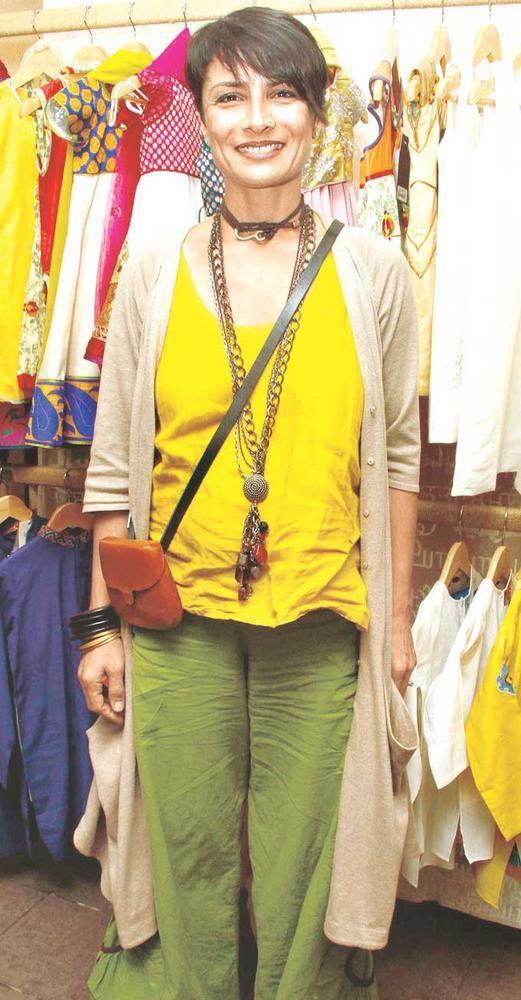 Adhuna Akhtar Kept Small Orange Color Clutch