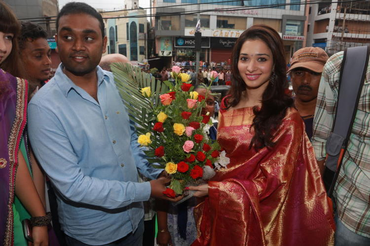 Tamanna With Bouquet At Showroom Launch Event