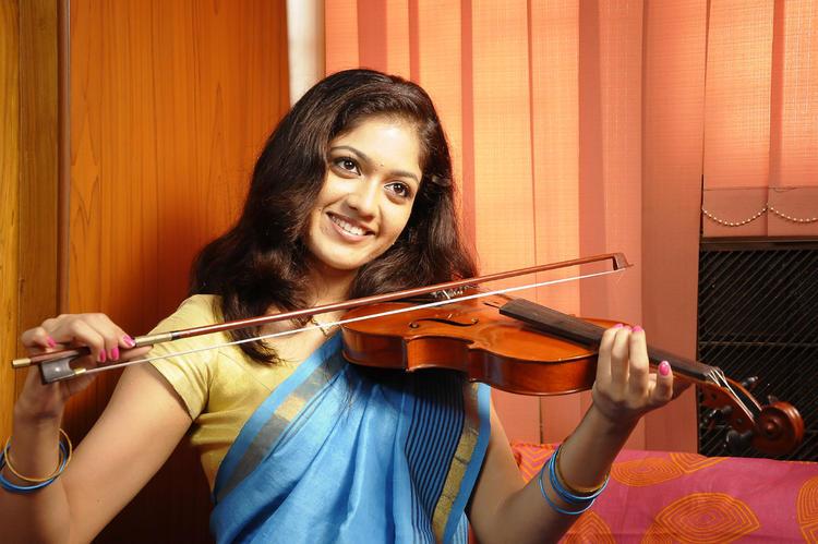 Meghana Raj Violin Play Still In Lucky Movie