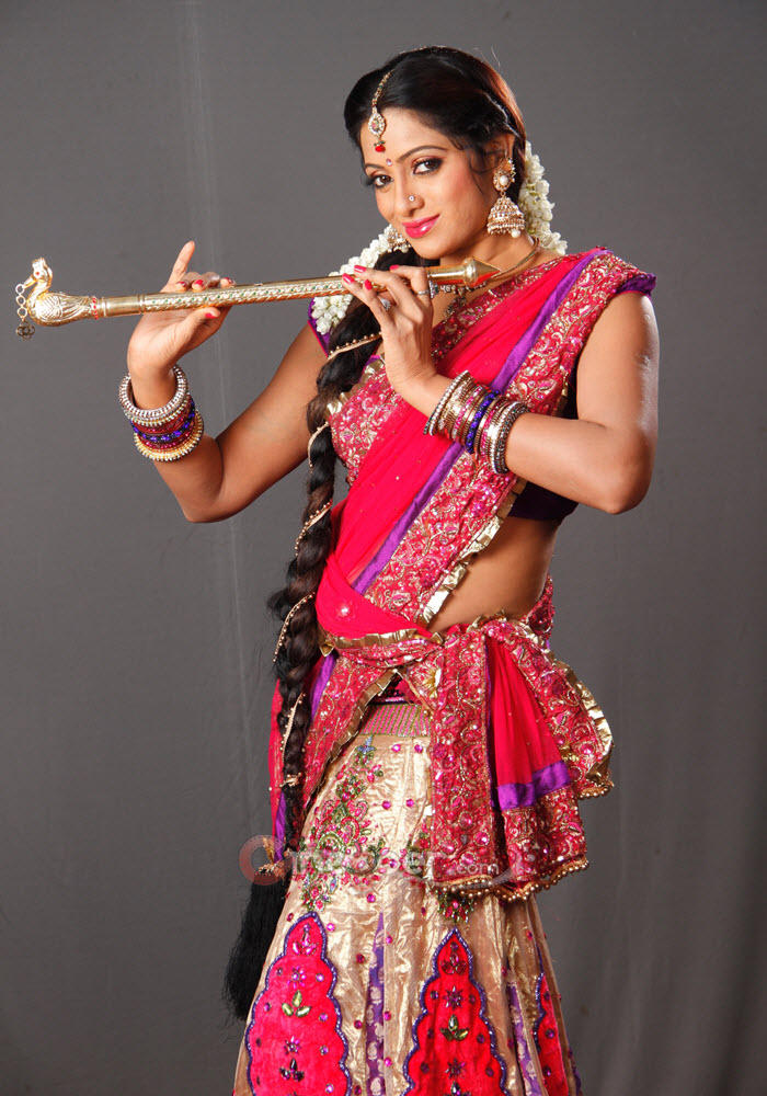 Udaya Bhanu Clicked A Pose With A Flute