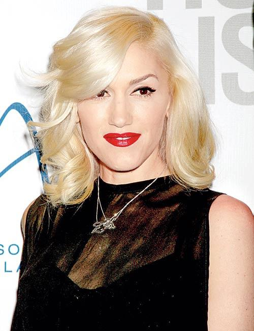 Gwen Dazzling Face Look Complete With Red Lipstick