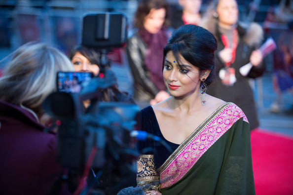 Shriya With Camera Man At The Premiere Show Of Midnight Children