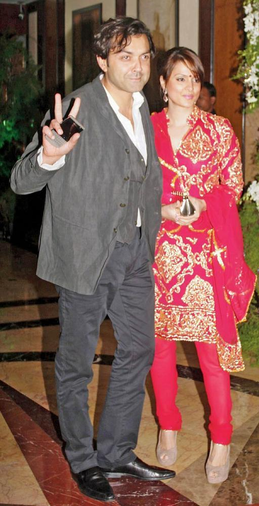 Bobby With Wife Tanya Deol In Red Chudidar Still