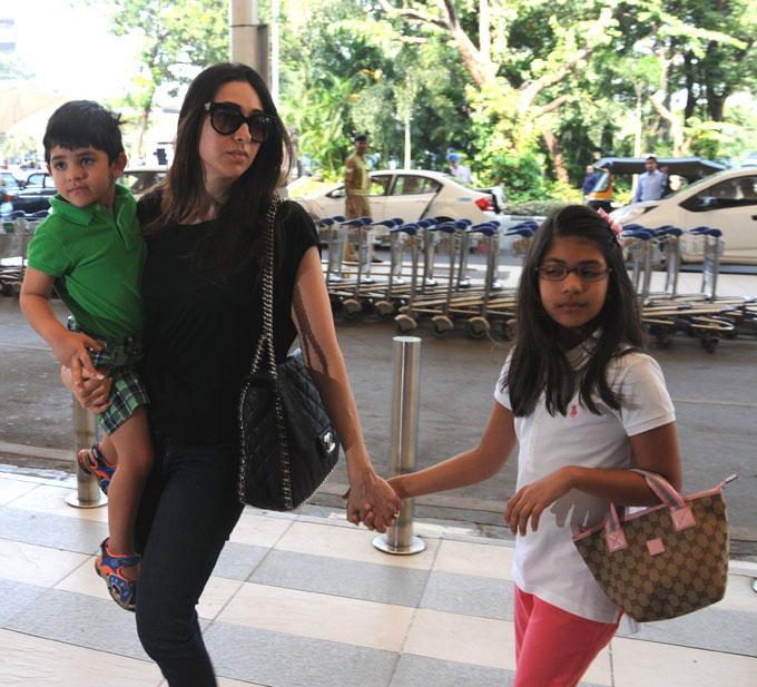 Karisma with son Kiaanand daughter Samaira Spotted At Mumbai Airport