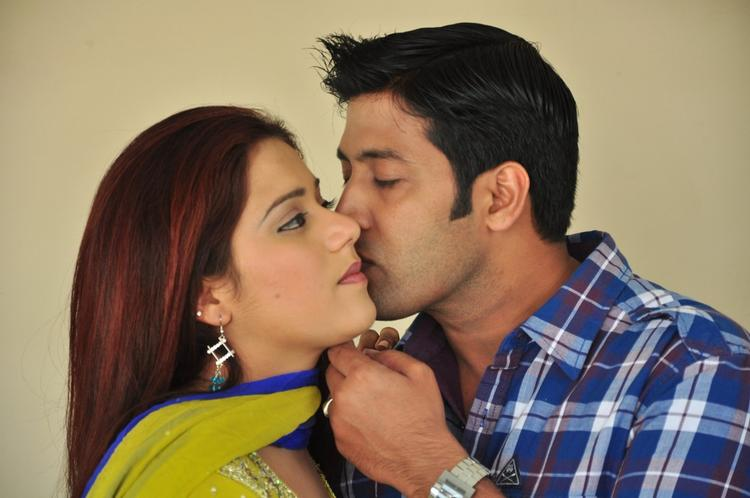 Akash And Swetha In Romantic Mood Still