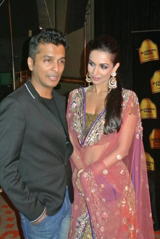 Vikram And Malaika Gives Pose For Camera At BPFT 2012