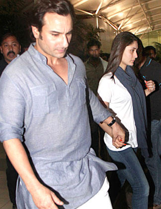 Saif And Kareena Snapped At At Mumbai Airport