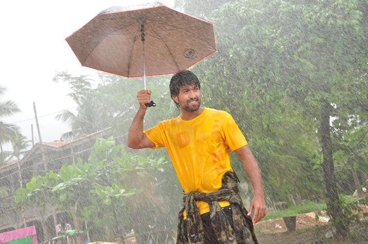 Yash With Umbrella In Rain Photo Still From Sandalwood Drama Movie