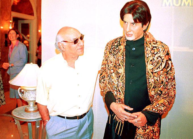 The Legendary Filmmaker Yash Admires A Wax Statue Of Big B