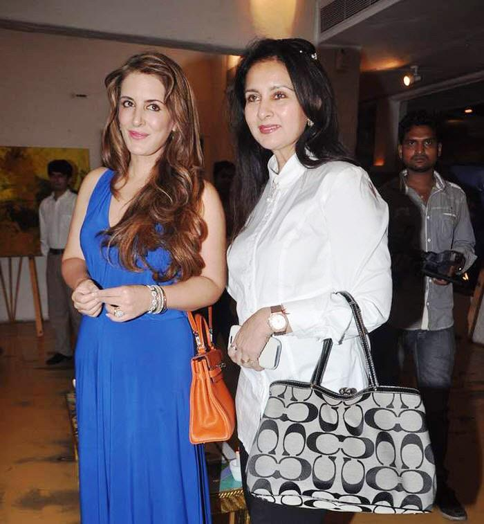 Pria And Poonam Spotted At Rouble Nagi's Painting Exhibition