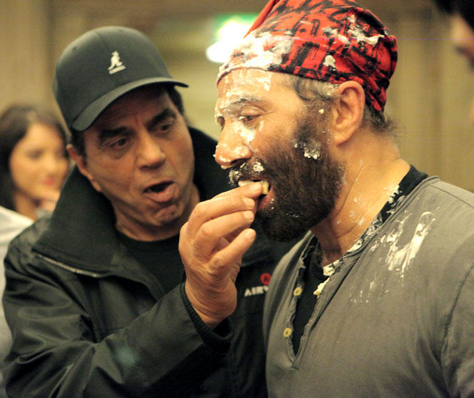 Dad Dharmendra Feeds A Piece Of Cake To Son Sunny Deol