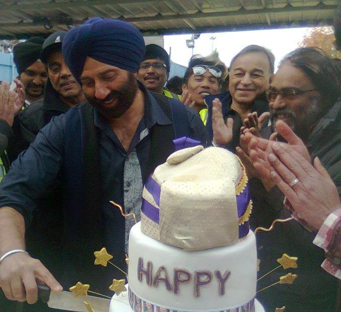 Sunny Deol Cuts The Cake At His Birthday Bash