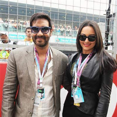 Ajay And Sonakshi Pose For Camera At F1 Indian Grand Prix