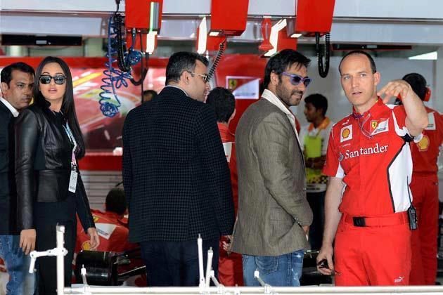 Ajay,Sonakshi And Shooter Gagan Narang At The F1 Indian Grand Prix 2012