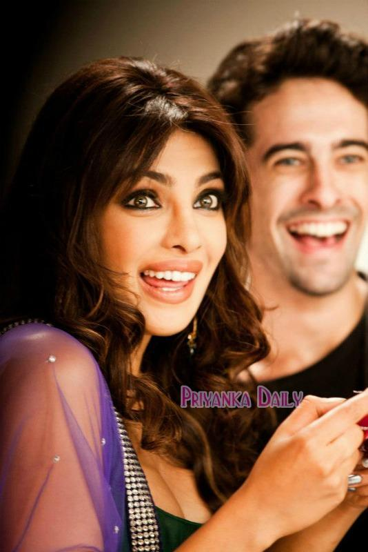 Priyanka Smile With Expression Pose For Camera At Sets Of Nikon Add