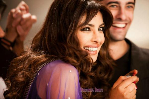 Priyanka Smiling Face Look Still With Co Star At Sets Of Nikon Add