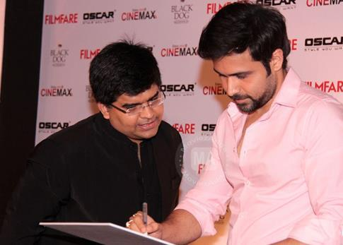 Emraan Hashmi Signs The Filmfare Poster With Editor Jitesh Pillaai