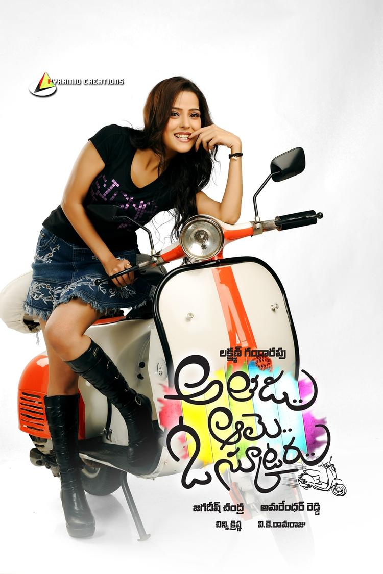 Priyanka With Scooter Nice Look With Cute Smiling Still Wallpaper