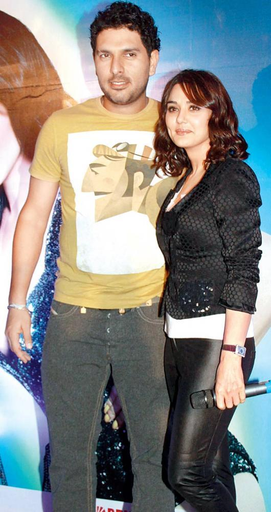 Yuvraj And Preity Pose For The Shutterbugs At Hungama Ho Gaya Album Launch