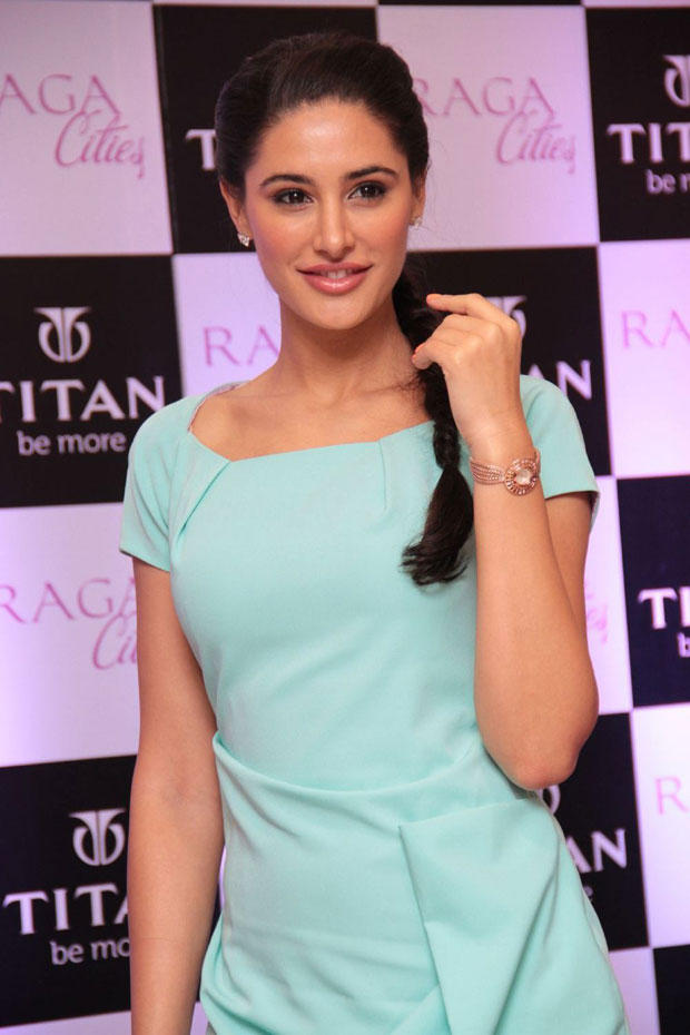 Nargis Fakhri Pose For Camera At Titan Raga Cities Collection Launch