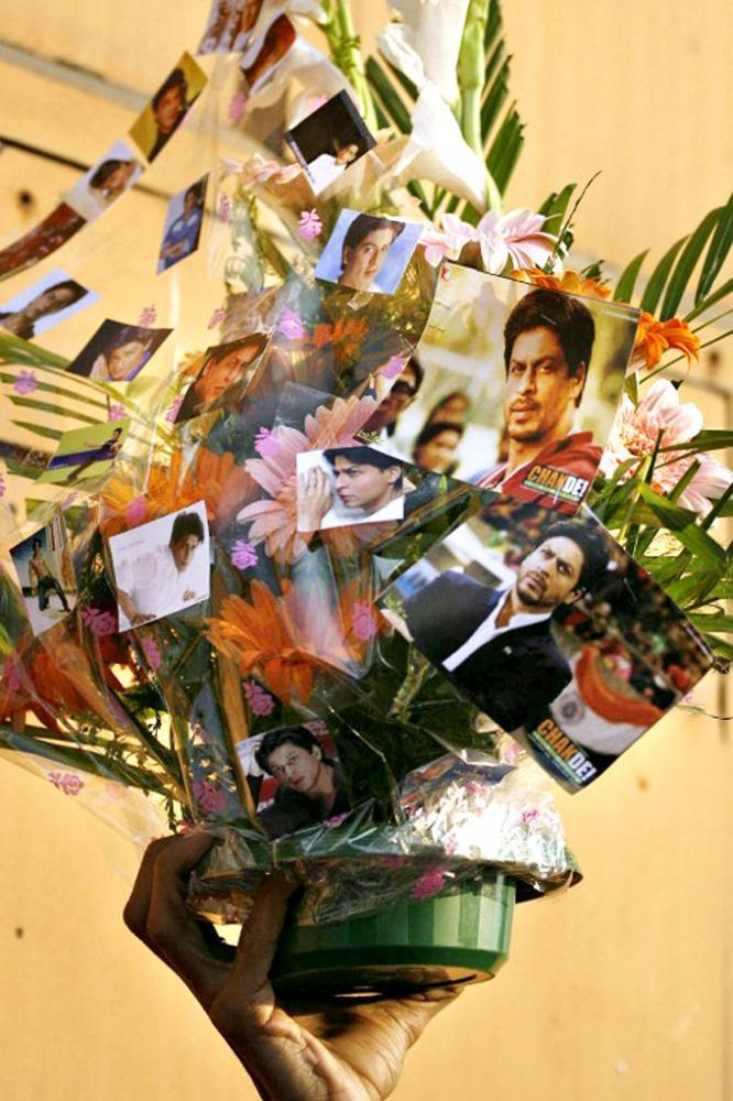 An Australian Fan Holds A Bouquet Of Flowers With Photographs Of SRK