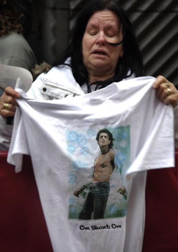 A Fan Holds A T-shirt Featuring SRK