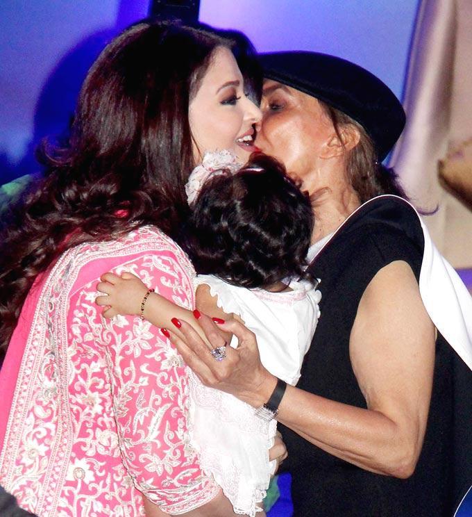 A Celeb Kisses Aishwarya At French Civilian Award 2012