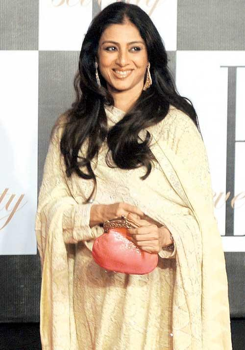 Tabu Nice Look With Cute Smiling Still