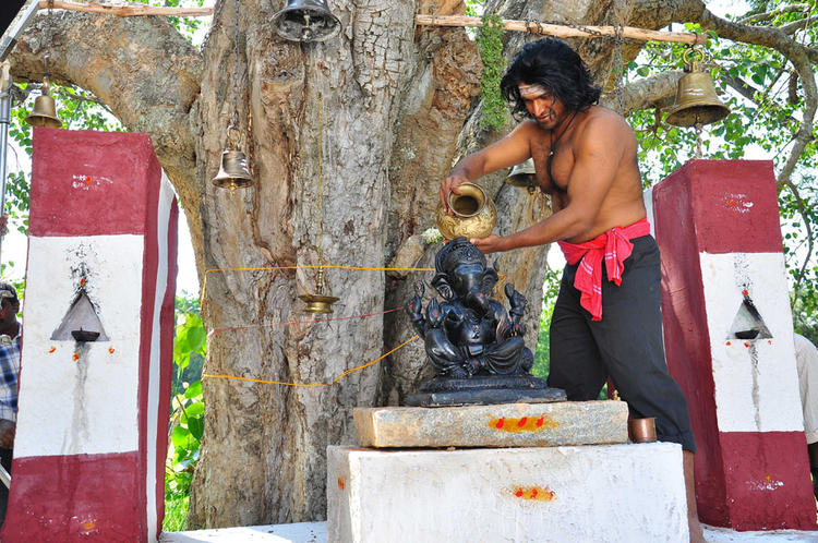 Puneeth Pouring Water On Lord Ganesh Photo Clicked From Yaare Koogadali Kannada Movie