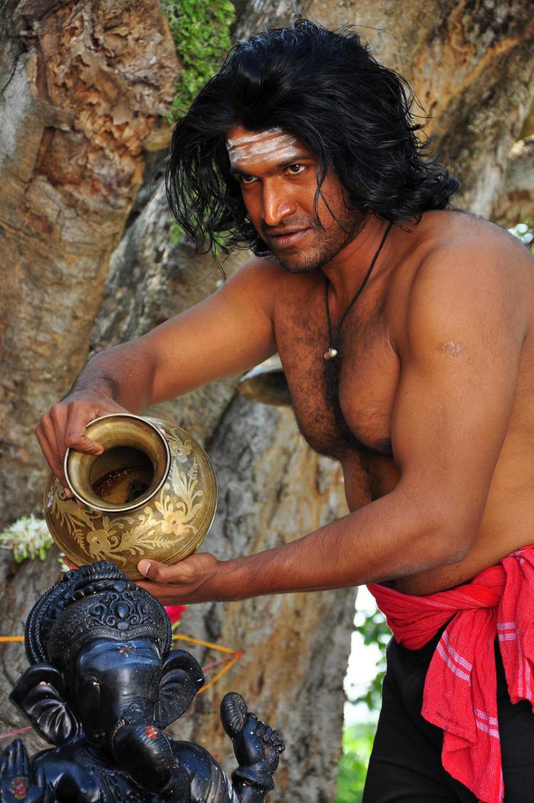 Puneeth Worship Lord Ganesh Photo Still From Yaare Koogadali Kannada Movie