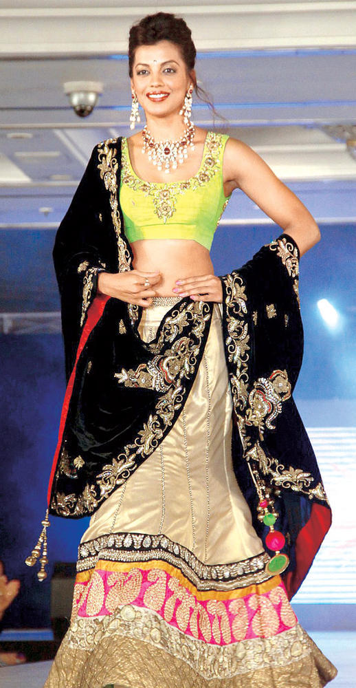 Mugdha Walks On The Ramp In Green Black And Gold Combination Dress