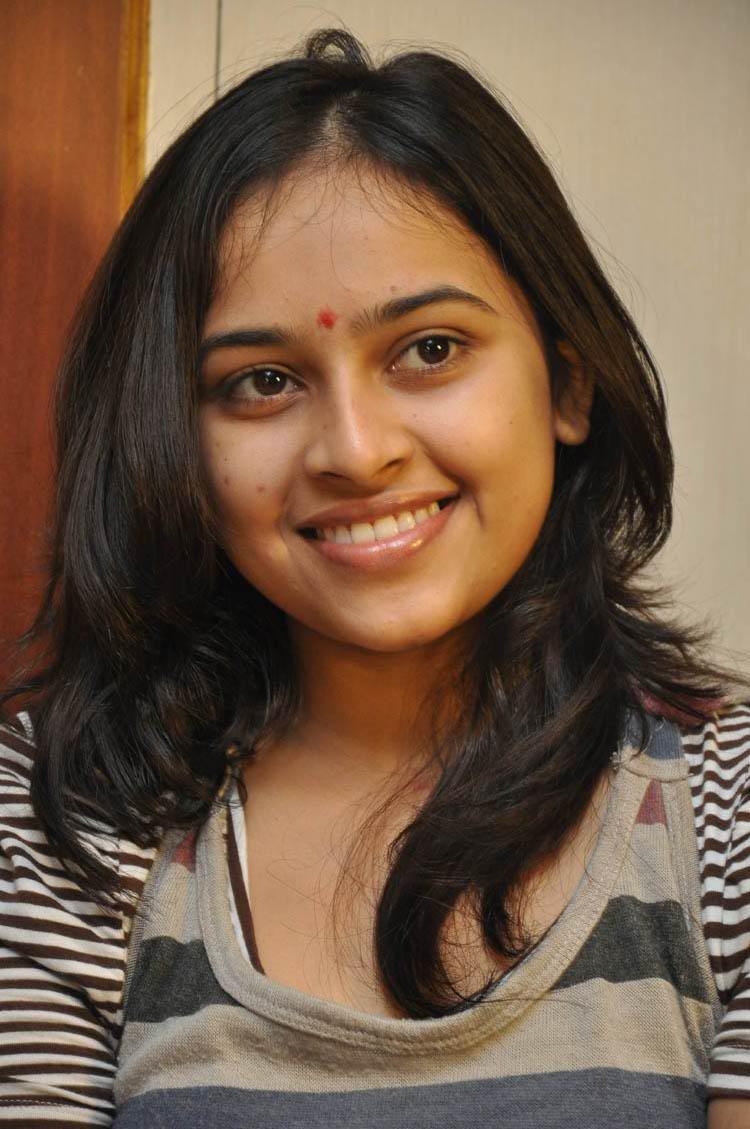 Sri Divya Smiling Still With Flaunt Hair Style