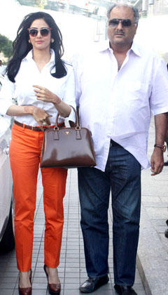 Sridevi With Hubby Boney Posed For Camera At Porsche Car Showroom