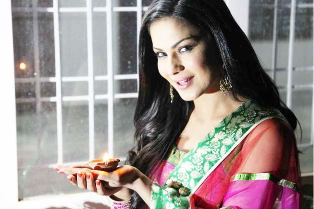 Veena Malik With A Diya At Diwali Celebration