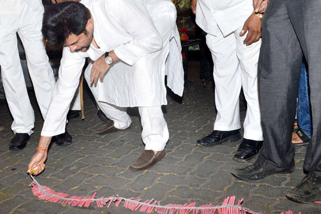 Anil Kapoor Lighting The Crackers At Diwali Celebration