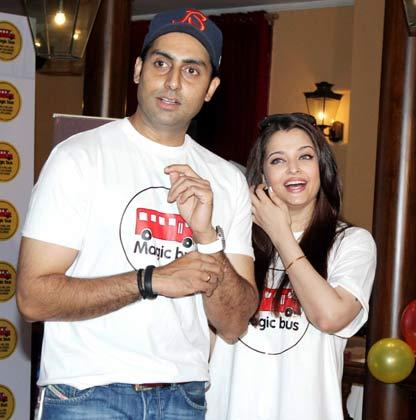 Aishwarya With Hubby Abhishek Great Look In White T-Shirt At Magic Bus Event On Children's Day