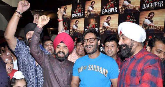 Ajay Devgan Smiling At The Special Screening Of SOS