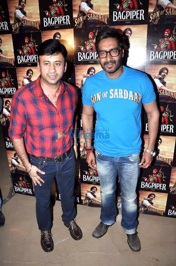 Ajay Posed With A Friend At Son Of Sardaar Special Screening