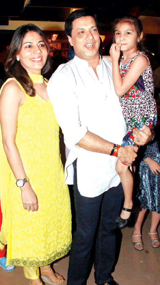 Madhur Arrives With His Wife Renu At The Special Screening Of SOS