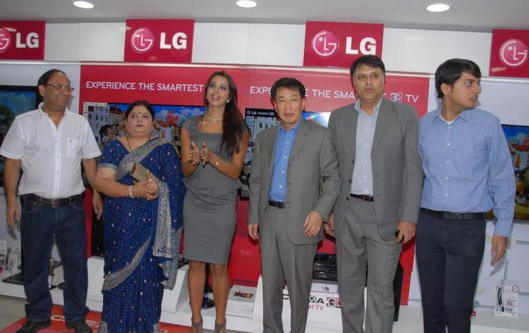 Sanjana Pose For Camera At Bajaj Electronics Launching Event