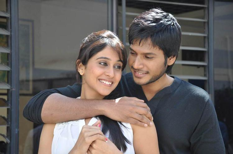Sandeep And Regina Smiling Still From Routine Love Story Movie