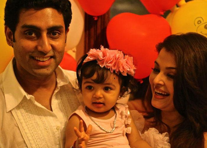 Abhishek And Aishwarya With Their Daughter Aaradhya Smiling Still