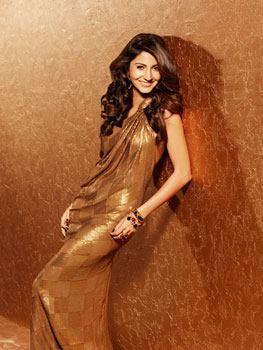 Anushka Sexy And Spicy Look Photo Shoot In Golden Dress