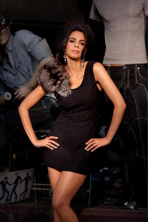 Mallika Hot Expression In Mini Dress Photo Shoot