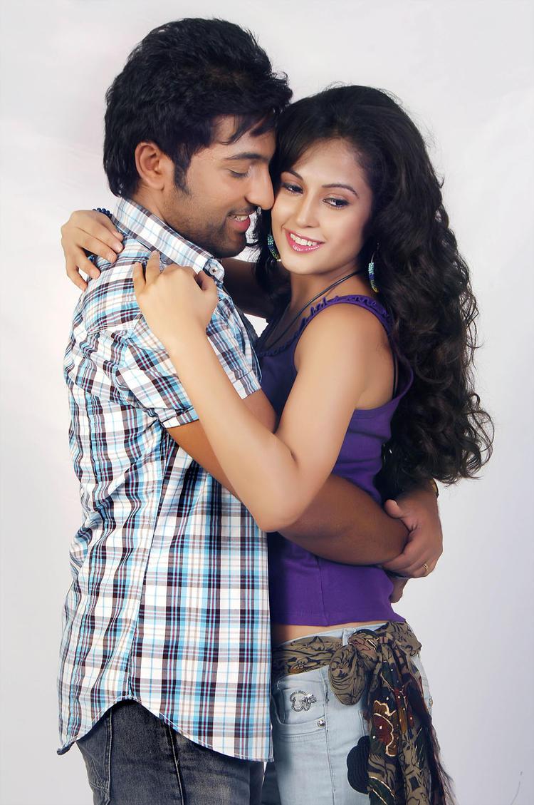 Vikram And Nikitha Romantic Still From Race Movie