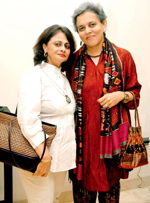 Brinda And Puja Posed For Camera At An Art Evening