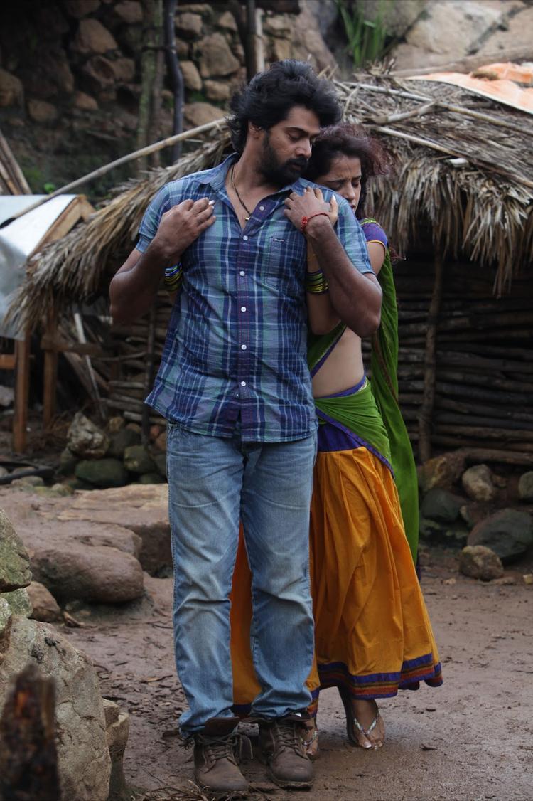 Naveen And Piaa Hug Still From Telugu Movie Dhalam