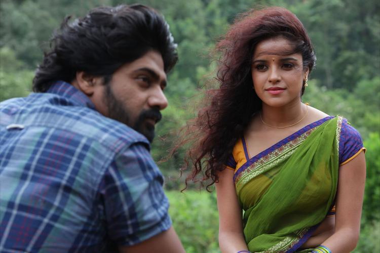 Naveen And Piaa Nice Look Still From Telugu Movie Dhalam