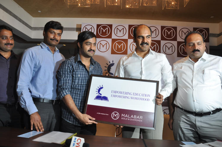 Jr Ntr With Emporing Education Empowring Womanhood Logo At Malabar Gold And Dimond Launch Event